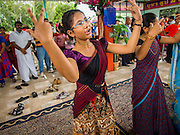 31 AUGUST 2014 - SARIKA, NAKHON NAYOK, THAILAND: Hindu women dance during the Ganesh Festival at Shri Utthayan Ganesha Temple in Sarika, Nakhon Nayok. Ganesh Chaturthi, also known as Vinayaka Chaturthi, is a Hindu festival dedicated to Lord Ganesh. It is a 10-day festival marking the birthday of Ganesh, who is widely worshiped for his auspicious beginnings. Ganesh is the patron of arts and sciences, the deity of intellect and wisdom -- identified by his elephant head. The holiday is celebrated for 10 days, in 2014, most Hindu temples will submerge their Ganesh shrines and deities on September 7. Wat Utthaya Ganesh in Nakhon Nayok province, is a Buddhist temple that venerates Ganesh, who is popular with Thai Buddhists. The temple draws both Buddhists and Hindus and celebrates the Ganesh holiday a week ahead of most other places.    PHOTO BY JACK KURTZ