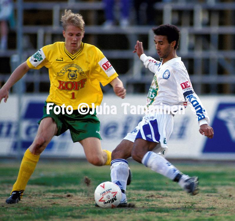 08.05.1994, Tammela Stadium, Tampere, Finland. Veikkausliiga, Ilves v FC Kuusysi..Neno (Kuusysi) v Toni Kuivasto (Ilves).©JUHA TAMMINEN