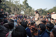 29th Dec. 2012. A woman states her thoughts amidst a large group of demonstrators who gathered in the Jantar Mantar area of New Delhi in reaction to the gang-rape of a young medical student in the Indian capital. Earlier that day news broke that the victim had died of her injuries.