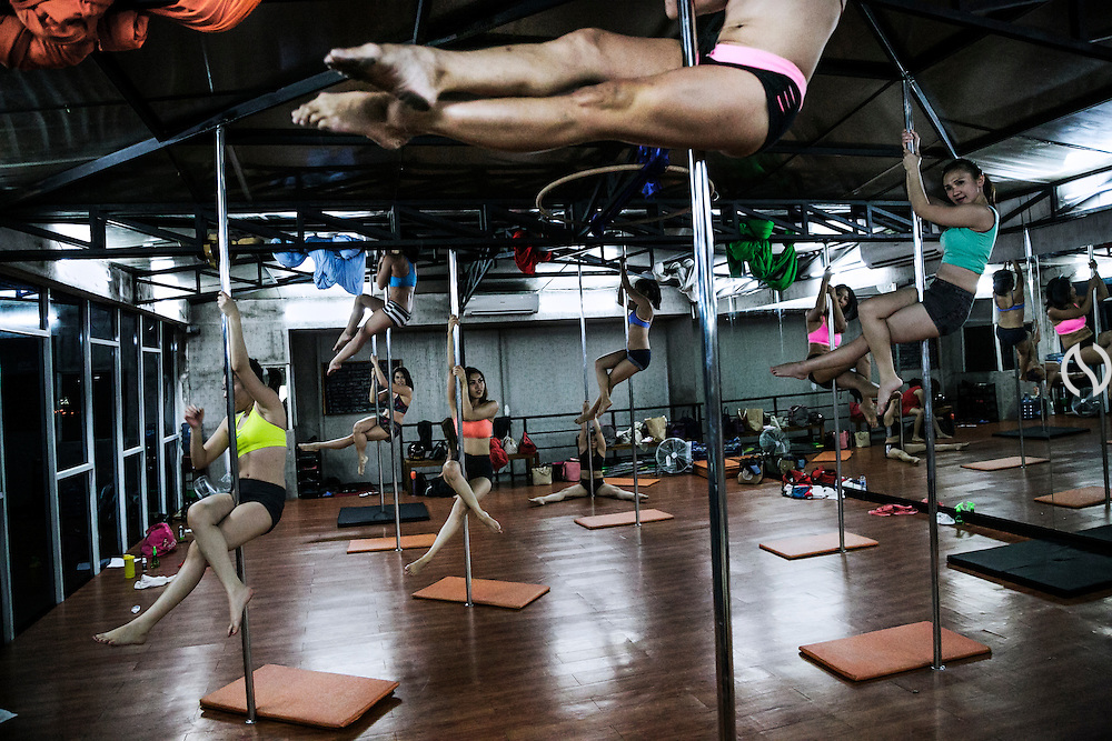 JAKARTA - INDONESIA; THURSDAY, SEPTEMBER 25, 2014; INDONESIA ECONOMIC RISING:  Middle class women join a pole dance class at Pole Dance Studio in Kemang, Jakarta, Indonesia, Thursday, September 25, 2014. Annual income rate per capita has increased in noteworthy and affect to expenditure for leisure and vacation. According to Asian Development Bank's 2014 report, Indonesia economy growth potential is in creative industry after for years relies heavily on natural resources such as mineral mining and palm oil. By the presidency of Joko Widodo, as a product of the third people election after the People Power Revolution in 1998, Indonesia is more confident in the economy growth and optimistic to become equal in quality to Brazil and China's economy growth. The emerging of Indonesia economy for the last one and a half decade after the end of Suharto's Dictatorship has been in significant way, the per capita growth has reached 400% under Susilo Bambang Yudhoyono presidency. Indonesia is home for 74 million of middle class as estimated by Boston Consulting Group, and  will double in 2020.