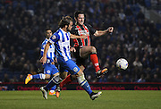 AFC Bournemouth striker Yann Kermorgant battles for the ball during the Sky Bet Championship match between Brighton and Hove Albion and Bournemouth at the American Express Community Stadium, Brighton and Hove, England on 10 April 2015. Photo by Phil Duncan.