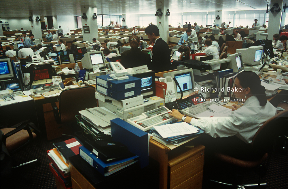 In Europe's largest currency trading floor at National Westminster Bank, a 1990s female banker works at her computer at  in the City of London (aka The Square Mile), the capital's financial centre, on 20th May 1993, in London, England.