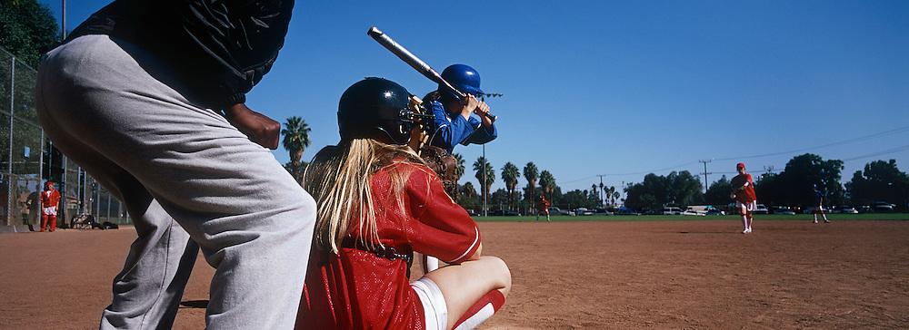 Girls (13-17) playing baseball