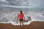 A young girl walks in the surf on the beach at Wailea, Hawaii on the island of Maui on July 20, 2008. (Photo by Kevin Bartram)
