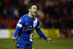 Peterborough United's Tommy Rowe celebrates scoring the winning penalty - Photo mandatory by-line: Joe Dent/JMP - Tel: Mobile: 07966 386802 17/02/2014 - SPORT - FOOTBALL - Swindon - County Ground - Swindon Town v Peterborough United - Johnstone's Paint Trophy - Southern Area Final - Second Leg