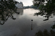 Paris . Flooding . The Seine river  Paris city center. Saint Louis island quay under the water