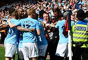 A steward caught in the crush between celebrating Manchester City players and fans after Raheem Sterling (7) of Manchester City scored the winner during the Premier League match between Bournemouth and Manchester City at the Vitality Stadium, Bournemouth, England on 26 August 2017. Photo by Graham Hunt.