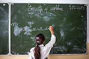 Girl writing to the board in one of the local schools in Frumusina. In Frumusani, the Roma Education Fund—supported by the World Bank, Open Society Foundations, the European Union, and other donors—is working to remove the barriers local Roma children face to complete their primary school education.