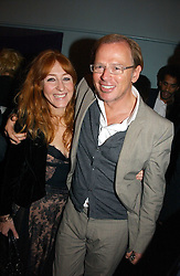 CHARLOTTE TILBURY and DAVID COLLINS at a party to celebrate the publication of 'The year of Eating Dangerously' by Tom Parker Bowles held at Kensington Place, 201 Kensington Church Street, London on 12th october 2006.<br />
