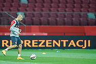 Poland's Kamil Grosicki kicks the ball while warm up during official training one day before the EURO 2016 qualifying match between Poland and Germany on October 10, 2014 at the National stadium in Warsaw, Poland<br /> <br /> Picture also available in RAW (NEF) or TIFF format on special request.<br /> <br /> For editorial use only. Any commercial or promotional use requires permission.<br /> <br /> Mandatory credit:<br /> Photo by © Adam Nurkiewicz / Mediasport