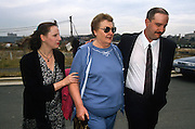 Betty Nicholson, mother of accused double agent Harold James a CIA employee arrested for spying for Russia outside the federal court November 26, 1996 where her son is being arraigned on espionage charges . Walking with Betty Nicholson is brother Robert and his wife.