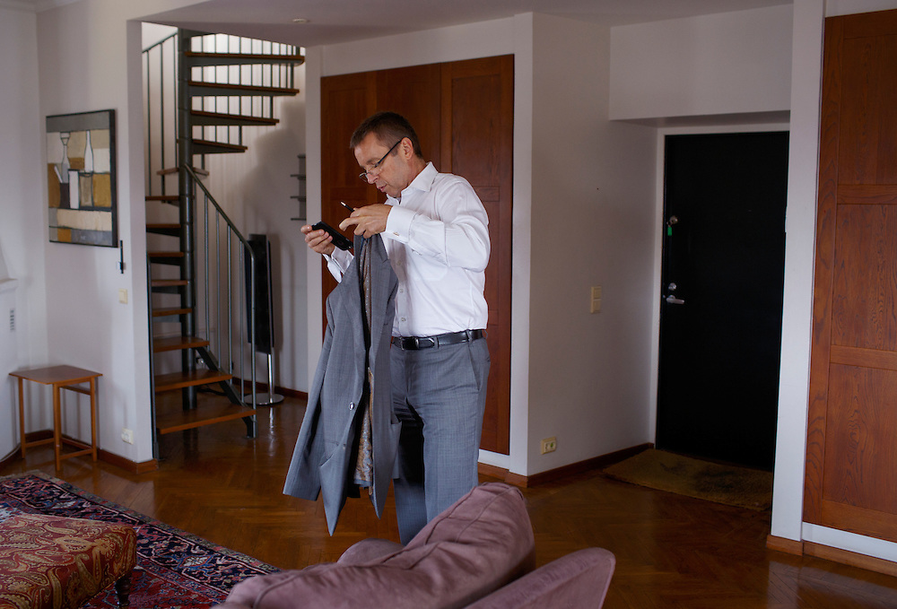 Ivan Mikloš removes his coat at his apartment on May 25, 2015 in Kyiv, Ukraine. Mr. Mikloš is Chief Advisor to the Minister of Finance of Ukraine and Advisor to the Minister of Economic Development and Trade of Ukraine.