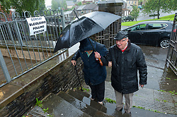 © Licensed to London News Pictures. 08/06/2017. Penygraig, Rhondda, Wales, UK. Voters arrive in the pouring rain at the Soar Centre in Penygraig, Rhondda, in the constituency of Rhondda, to cast their vote on the day of the general election in Wales, UK. Photo credit: Graham M. Lawrence/LNP
