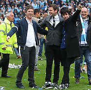 Noel Gallagher of Oasis and Johnny Marr of The Smiths, along with Gordon Smart of the Scottish Sun, celebrate Manchester City winning the  Barclays Premier League at the Etihad Stadium, Manchester<br /> Picture by John Rainford/Focus Images Ltd +44 7506 538356<br /> 11/05/2014