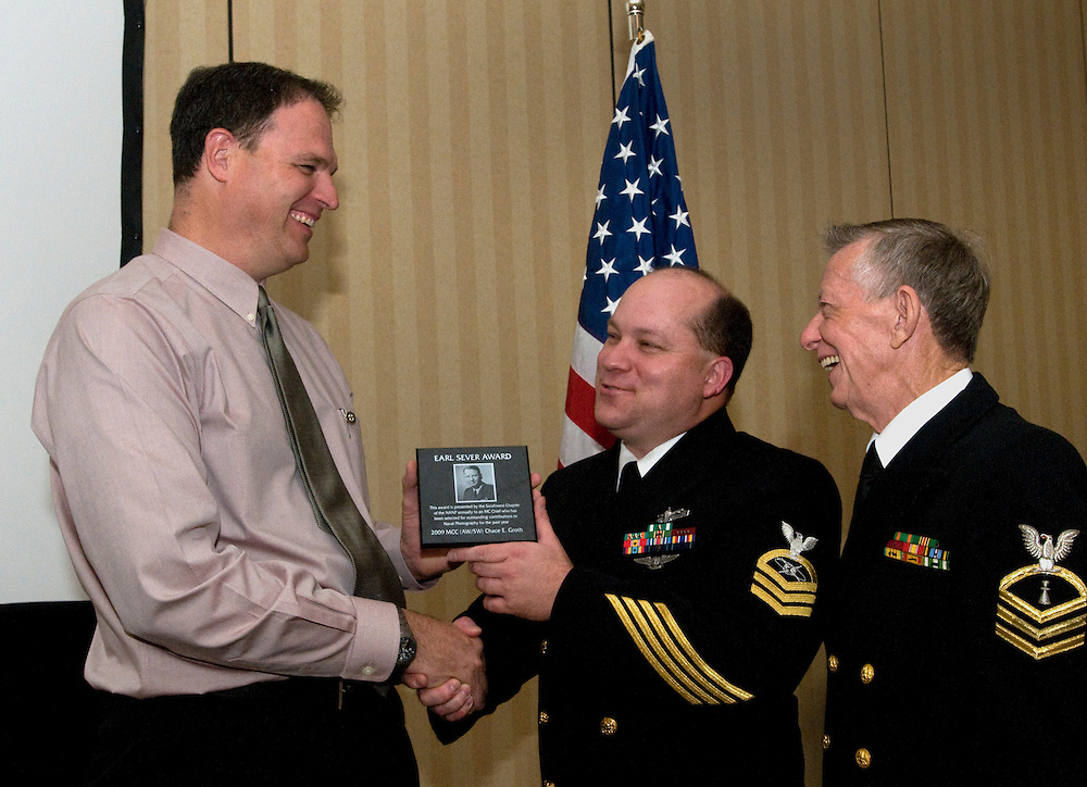 PENSACOLA, Fla. (Oct. 27, 2009) -- U.S. Navy photo veteran and President of the National Association of Naval Photography (NANP) Greg Mcreash, left, presents Chief Petty Officer Chace Groth the Earl Sever Award for Leadership during the awards banquet for the National Association of Naval Photography (NANP). Members have gathered for a reunion in Pensacola Beach, Florida for a week long event of tours, meetings and awards banquet.  Photo by Johnny Bivera