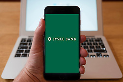 Using iPhone smart phone to display website logo of JYSKE Bank a Danish Bank