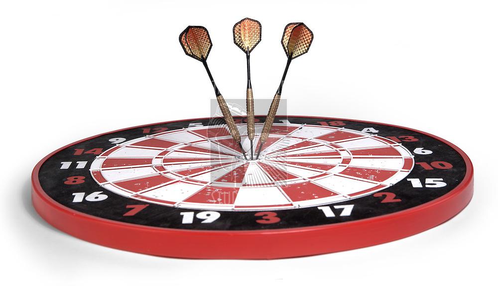 darts hitting dartboard bullseyes on white background