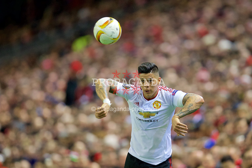 LIVERPOOL, ENGLAND - Thursday, March 10, 2016: Manchester United's Marcos Rojo takes a throw-in during the UEFA Europa League Round of 16 1st Leg match against Liverpool at Anfield. (Pic by David Rawcliffe/Propaganda)