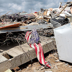 Kyle Green | The Roanoke Times<br /> 4/29/201 An American flag lays across rubble of a mobile home grouping that was destroyed by the Wednesday night EF-3 tornado in Glade Spring Virginia. A resident of the mobile home grouping, Barbara Keesee, was killed during the tornado.