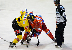 Marcel Rodman of Vienna vs Rok Ticar of Acroni Jesenice during ice-hockey match between HK Acroni Jesenice and EV Vienna Capitals in 13th Round of EBEL league, on October 22, 2010 at Podmezakla, Jesenice, Slovenia. (Photo By Vid Ponikvar / Sportida.com)