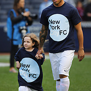 Manchester City players including Carlos Tevez wearing New York City FC shirts as they are accompanied by children onto the pitch before the Manchester City V Chelsea friendly exhibition match at Yankee Stadium, The Bronx, New York. Manchester City won the match 5-3. New York. USA. 25th May 2012. Photo Tim Clayton