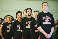 Rutland listen to the National Anthem during the boys high school semi final basketball game between the Rutland Raiders and the Rice Green Knights at Patrick Gym on Saturday afternoon February 27, 2016 in Burlington. (BRIAN JENKINS/for the FREE PRESS)