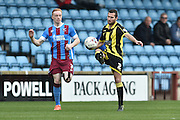 Burton Albion defender Phil Edwards (2) takes ball  during the Sky Bet League 1 match between Scunthorpe United and Burton Albion at Glanford Park, Scunthorpe, England on 9 April 2016. Photo by Ian Lyall.