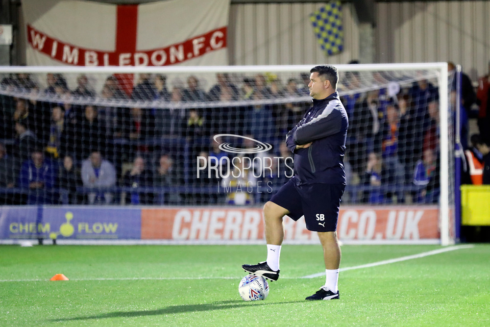 AFC Wimbledon first team coach Simon Bassey  watching the warm up during the EFL Sky Bet League 1 match between AFC Wimbledon and Milton Keynes Dons at the Cherry Red Records Stadium, Kingston, England on 22 September 2017. Photo by Matthew Redman.