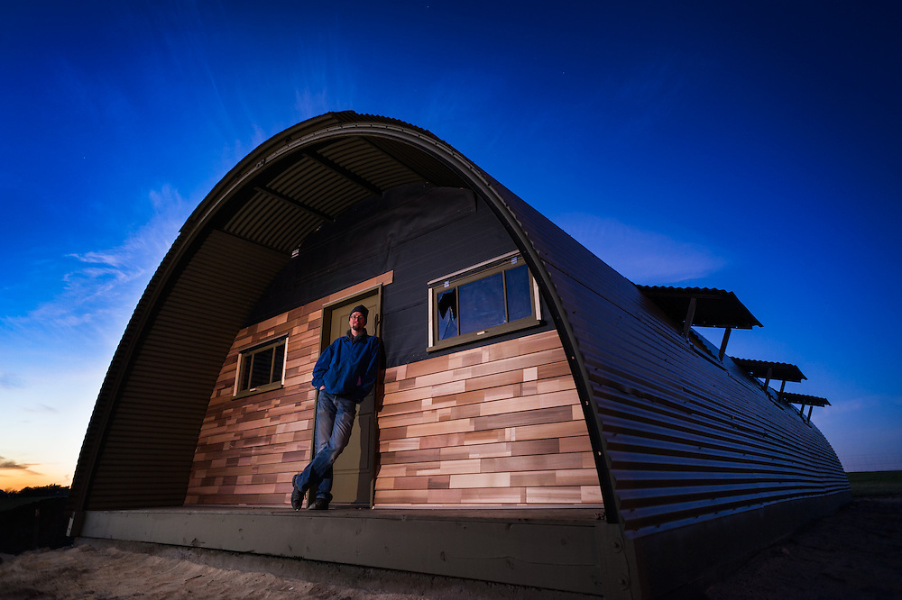 Todd Hintz, WWII reenactor, with the salvaged and restored WWII quonset hut placed at the Little Log House Pioneer Village in Hastings, Minnesota