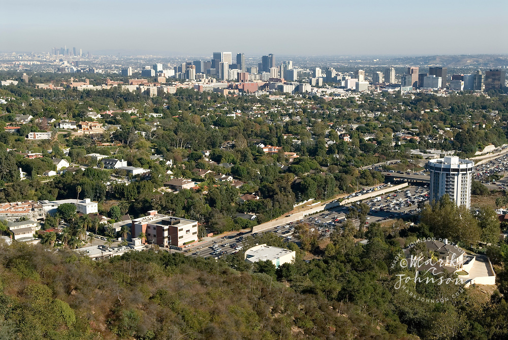 From right to left: Westwood, Century City, Downtown Los Angeles in far left background, California. The 405 Freeway is in foreground.