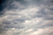 Undulating grey and black clouds
