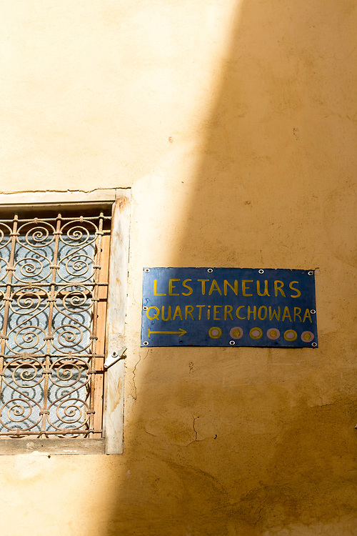 FEZ, MOROCCO - 3rd DECEMBER 2016 - Sign directing people to the Chouwara Tannery in the old Fez Medina, Middle Atlas Mountains, Morocco.