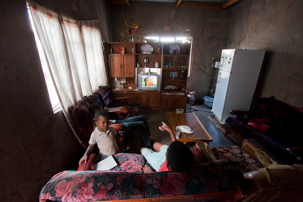 Inside the Moahis' family home in Kabakae Village, Ghanzi, Botswana. The family survives on food rations supplied by the government for an orphaned child.  (Marble Moahi is featured in the book What I Eat: Around the World in 80 Diets.)
