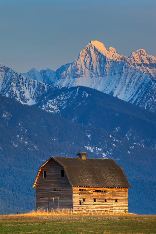 Barn and Mission Mountains near Polson, Montana.