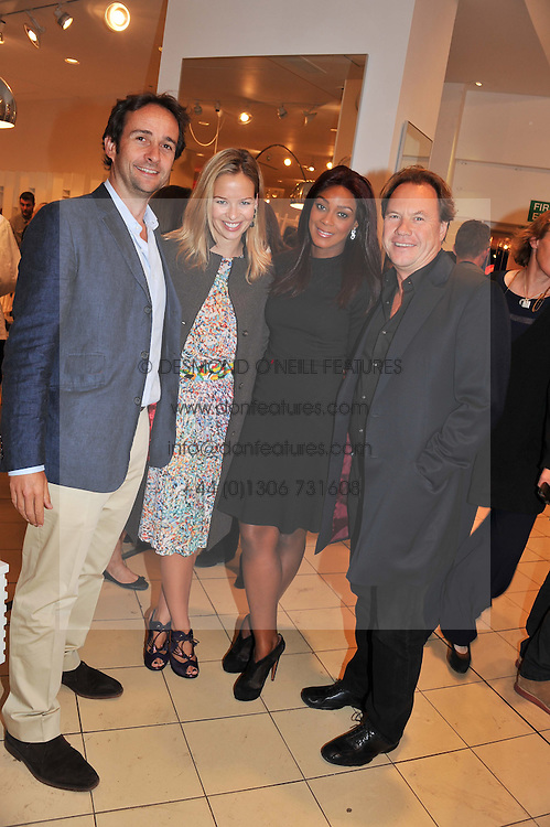 Left to right, MATT & MARISSA HERMER, PHOEBE VELA and JOHN HITCHCOX at an exhibition at The Conran Shop entitled Red to celebrate 25 years of The Conran Shop at the Michelin Building, 81 Fulham Road, London on 19th September 2012.