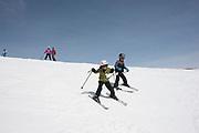 Family alpine skiing at Magic Mountain Ski Resort in Southern Idaho.
