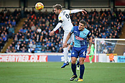 Peterborough United forward Matt Godden (9) rises above Wycombe Wanderers Adam El-Abd(6) during the EFL Sky Bet League 1 match between Wycombe Wanderers and Peterborough United at Adams Park, High Wycombe, England on 3 November 2018.