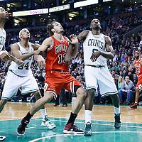13 February 2013: Chicago Bulls center Joakim Noah (13) vies for the rebound with Boston Celtics power forward Jeff Green (8) and Boston Celtics small forward Paul Pierce (34) during the Boston Celtics 71-69 victory over the Chicago Bulls at the TD Garden, Boston, Massachusetts, USA.