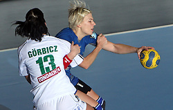 Anita Gorbicz is holding Dijana Golubic at EHF Champions league handball match in Group II between RK Krim Mercator and Gyori Audi Eto KC, on February 7, 2009, in Kodeljevo, Ljubljana, Slovenia. Gyori won 35:31. (Photo by Vid Ponikvar / Sportida)