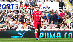 NEWCASTLE-UPON-TYNE, ENGLAND - Sunday, April 1, 2012: Liverpool's Andy Carroll looks dejected after being shown a yellow card for diving during the Premiership match against his former club Newcastle United at St James' Park. (Pic by Vegard Grott/Propaganda)