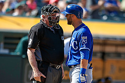 OAKLAND, CA - APRIL 17:  Alex Gordon #4 of the Kansas City Royals argues with umpire Brian Gorman #9 after a called third strike during the ninth inning against the Oakland Athletics at the Oakland Coliseum on April 17, 2016 in Oakland, California.  The Oakland Athletics defeated the Kansas City Royals 3-2. (Photo by Jason O. Watson/Getty Images) *** Local Caption *** Alex Gordon; Brian Gorman