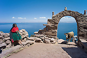 Gate on trail to the harbor, Taquile Island, Lake Titicaca, Puno, Peru