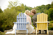 Bride and groom kissing while setting on adirondeck chairs at Josef Winery in the Willamette Valley