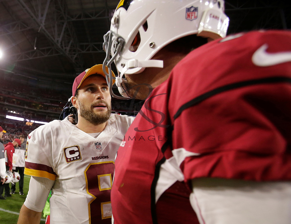 Washington Redskins quarterback Kirk Cousins (8) greets Arizona Cardinals quarterback Carson Palmer after an NFL football game, Sunday, Dec. 4, 2016, in Glendale, Ariz. The Cardinals won 31-23. (AP Photo/Rick Scuteri)