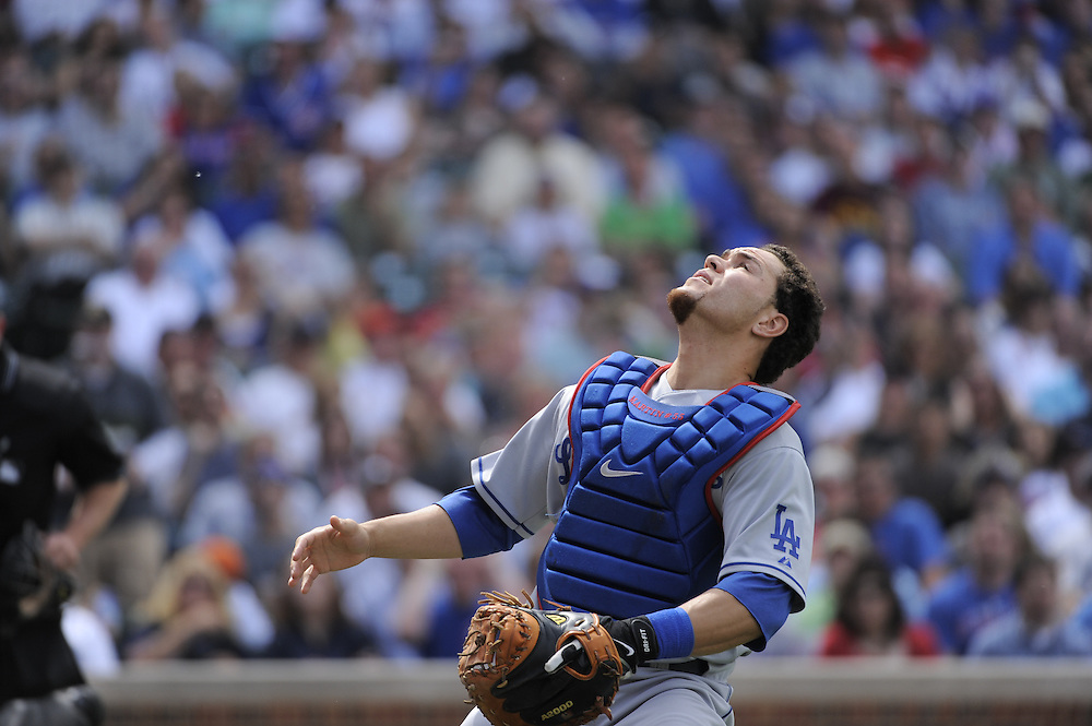 CHICAGO - MAY 30:  Russell Martin #55 of the Los Angeles Dodgers runs toward a pop foul during the game against the Chicago Cubs on May 30, 2009 at Wrigley Field in Chicago, Illinois.  The Cubs defeated the Dodgers 7-0.  (Photo by Ron Vesely)