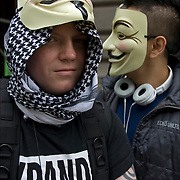 Close up of two masked &quot;Anonymous&quot; protester, at the &quot;Occupy Wall Street&quot;  protest  on September 17, 2011.<br /> <br /> Anonymous is a group initiating active civil disobedience and spread through the Internet while staying hidden, representing the concept of many online community users simultaneously existing as an anarchic, digitized global brain. <br /> <br /> It is also generally considered to be a blanket term for members of certain Internet subcultures, a way to refer to the actions of people in an environment where their actual identities are not known.