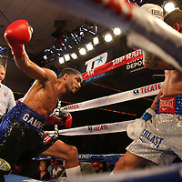 Gamalier Rodriguez (blue/black trunks) retains his NABO Featherweight Title against challenger Orlando Cruz (white trunks) at the Bahia Shriners Center on Saturday, April 19, 2014 in Orlando, Florida.  (AP Photo/Alex Menendez)