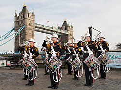 © Licensed to London News Pictures. 30/04/2014. London, UK. Royal Marines perform in front of Tower Bridge on 30th April 2014. The Royal Marines Corps of Drums are attempting to break the World record for the longest continuous drum roll as part of a year of celebrations to mark the 350th anniversary of the Royal Marines and raising money for the Royal Marines Charitable Trust Fund.  The current record stands at 28 hours, 19 minutes and 3 seconds and they hope to extend this to 64 hours. Photo credit : Vickie Flores/LNP