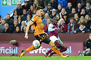 Aston Villa midfielder Albert Adomah (37) gets the ball through the legs of Wolverhampton Wanderers defender Danny Batth (6) during the EFL Sky Bet Championship match between Aston Villa and Wolverhampton Wanderers at Villa Park, Birmingham, England on 10 March 2018. Picture by Dennis Goodwin.