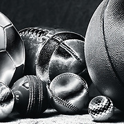 A studio shot of a Baseball, a Basketball an American Football, a soccer ball, a golf ball a tennis ball and a cricket ball. 20th October 2012. Photo Tim Clayton